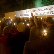 Activists and community members gathered to #ReclaimMLK during Black Lives Matter vigil in downtown Orlando