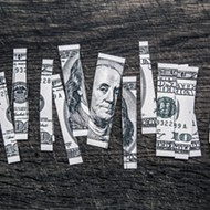 Rick Scott signs trimmed tax cut plan into law