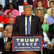 Disgraced ex-congressman Mark Foley sits behind Trump at Florida rally