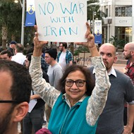 All the best signs from Orlando's 'No War with Iran' protest