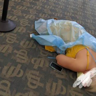 Photo showing woman lying on floor of Florida COVID-19 antibody clinic goes viral