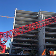 Crane collapse at AdventHealth parking garage hospitalizes one worker