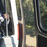 Disney World guest films monorail traveling with door open