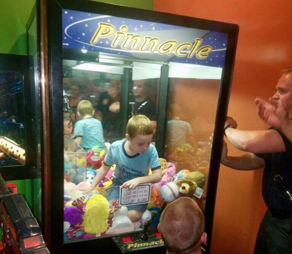 Child rescued from inside toy claw machine, Titusville officials say