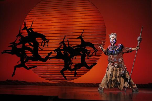 Buyi Zama as Rafiki heralds the return of 'The Lion King' to Orlando. - ©DISNEY.  PHOTO BY JOAN MARCUS.