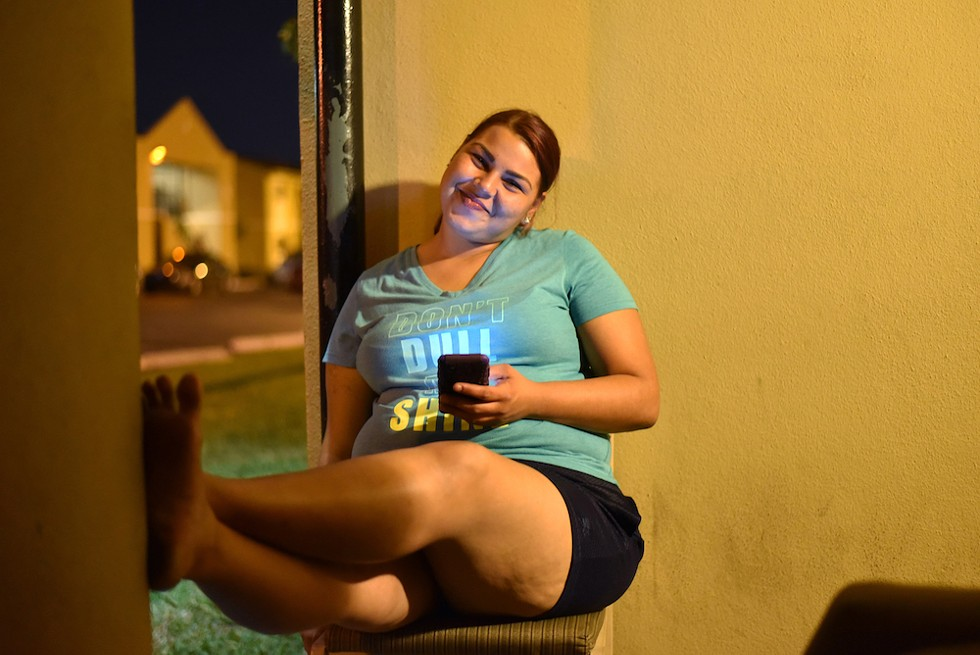 Desiree Torres taking a break after cooking - PHOTO BY MONIVETTE CORDEIRO