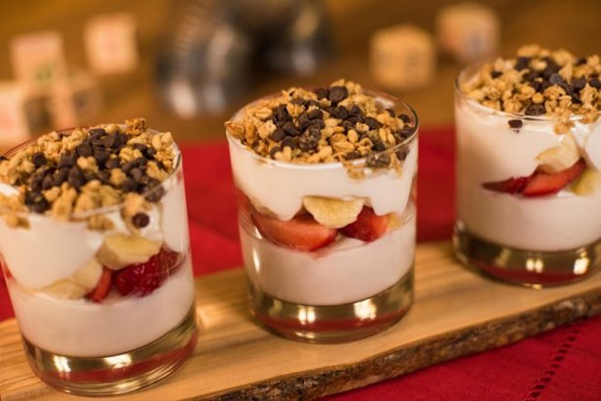 Banana Split Yogurt Parfait, Layers of banana-vanilla Greek yogurt with a touch of honey, bananas, strawberries, and pineapple topped with granola and chocolate chips. - PHOTO VIA DISNEY