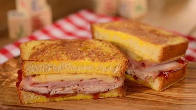 A grilled Monte Cristo with Raspberry Jam, layers of ham, turkey, Swiss, and raspberry jam - PHOTO VIA DISNEY
