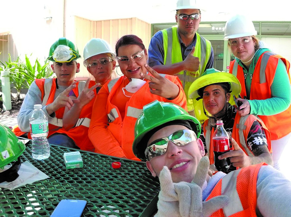 "Maria ""Betzy"" Santiago Burgos, second from left, at her construction job - PHOTO VIA DESIREE TORRES"