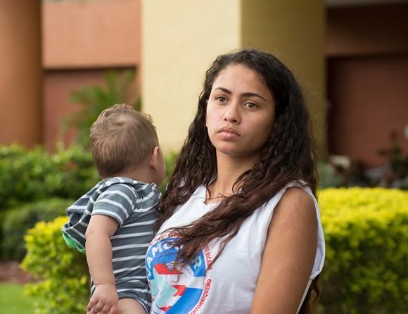 Ariana Colón and her baby evacuated from Puerto Rico. - PHOTO BY MONIVETTE CORDEIRO