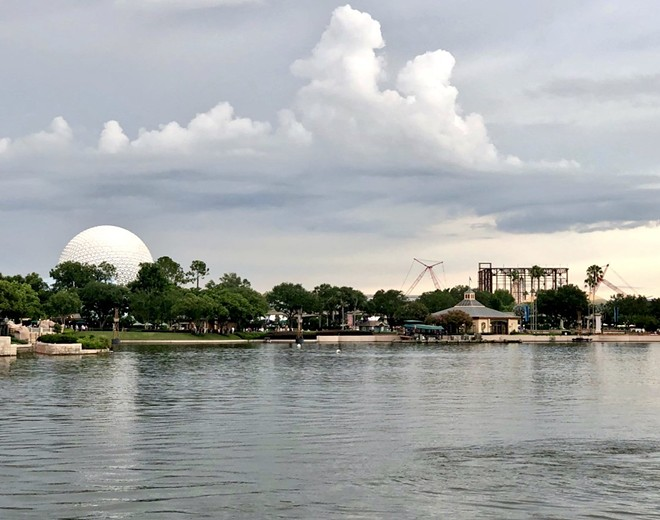 The Guardians of the Galaxy ride building rise beside Spaceship Earth as seen from World Showcase - IMAGE VIA BOSTON COASTER NERD | TWITTER