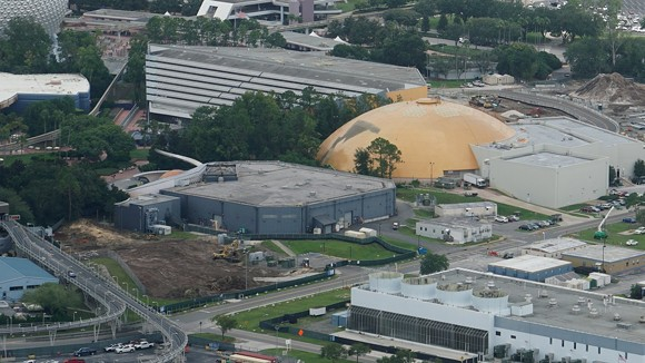 The land clearing for the new space-themed restaurant is now visible. The small, box-like unfinished corporate lounge can be seen in the middle left of the image adjenct to the Mission: Space attraction. - IMAGE VIA BIORECONSTRUCT | TWITTER