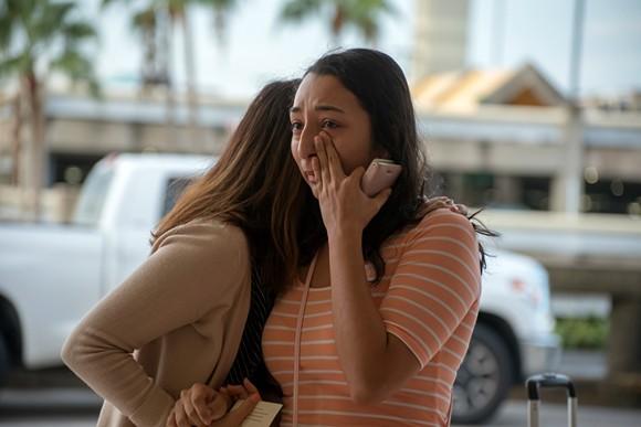 Pamela Juárez weeps as she's hugged by a staffer from U.S. Rep. Darren Soto's office. - PHOTO BY MONIVETTE CORDEIRO