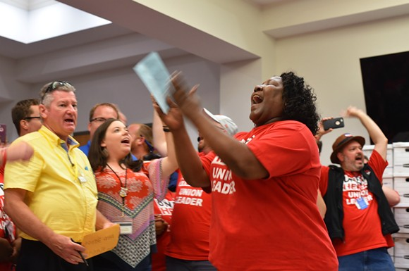 Disney union workers celebrate their historic contract agreement Thursday night. - PHOTO BY MONIVETTE CORDEIRO
