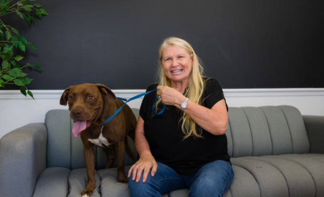 Jacki Webb and her friend Duke, who's currently available for adoption at OCAS - PHOTO COURTESY ORANGE COUNTY PRESS OFFICE