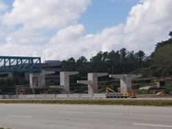The ramps for the pedestrian bridge now under construction.