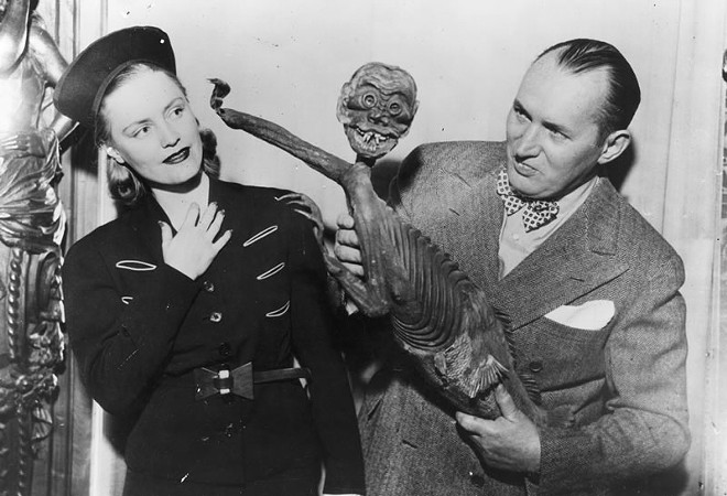 "Robert Ripley with the ""Fiji Mermaid"", which turned out to be a hoax consisting of a monkey torso attached to a fish. - PHOTO VIA RIPLEY'S BELIEVE IT OR NOT"