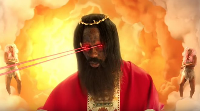 "PHOTO FROM ""STOP TRYING TO BE GOD"" VIA TRAVIS SCOTT/YOUTUBE"