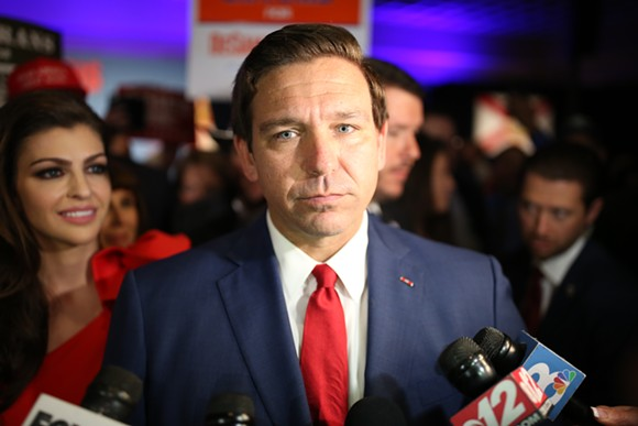Republican gubernatorial nominee Ron DeSantis speaks with reporters at his Election Day rally after declaring victory over his democratic opponent Andrew Gillum. - PHOTO BY JOEY ROULETTE