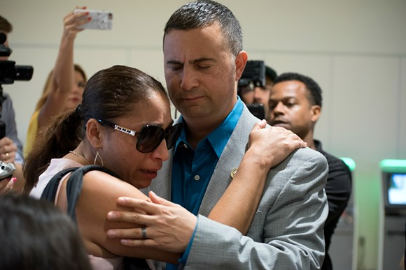 U.S. Rep. Darren Soto comforts Alejandra Juárez - PHOTO BY MONIVETTE CORDEIRO