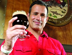 Sam Calagione, founder and president of Dogfish Head Craft Brewery, raises a glass