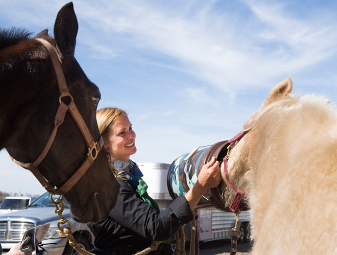 Lori Wilfcord-Herbenick, of Jacksonville, - waters her daughter's horse Flicka after the drive.