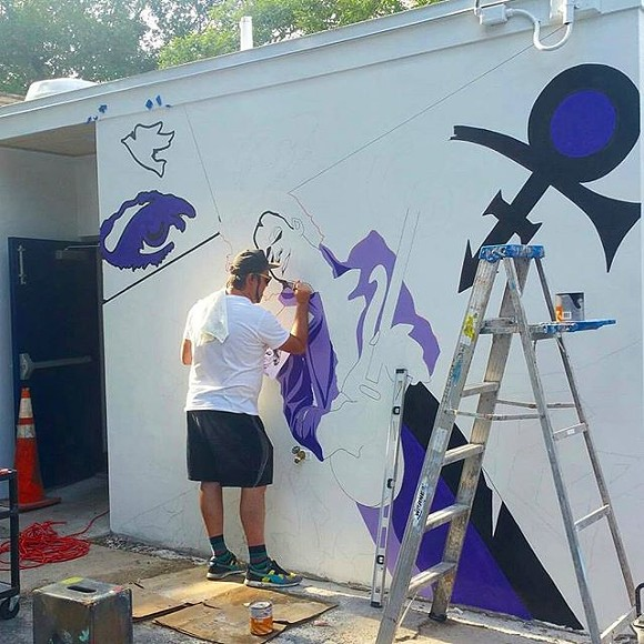 Artist Andrew Spear working on the new Prince mural at Hideaway Bar - PHOTO VIA SPEARLIFE/INSTAGRAM