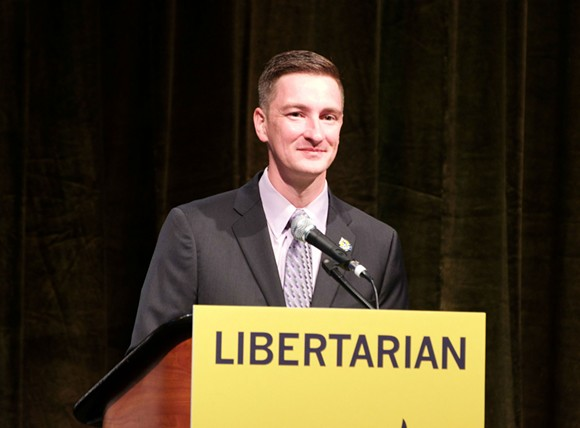 Nicholas Sarwark, chair of the Libertarian National Committee, speaks at the party's national convention in Orlando. - PHOTO BY MONIVETTE CORDEIRO