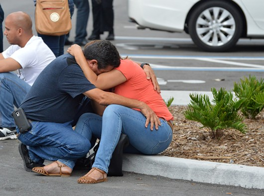 Family members of the victims of mass shooting at Orlando's Pulse nightclub hear news about their loved ones. - PHOTO BY MONIVETTE CORDEIRO