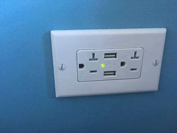 Power outlets with dual integrated USB charging ports in every room.