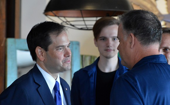 U.S. Sen. Marco Rubio speaks with a business owner affected economically by the Pulse shooting on Tuesday in Orlando. - PHOTO BY MONIVETTE CORDEIRO