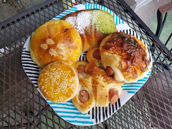Clockwise from top: Matcha bun, cheese and hot dog bun, garlic and hot dog bun, Sweetheart cookie, pineapple taro bun - HOLLY V. KAPHERR