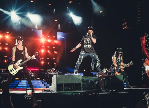 Duff, Axl, and Slash on stage together (!) at Camping World Stadium in Orlando. - KATARINA BENZOVA
