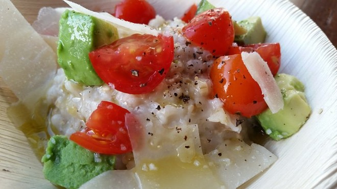 Oatmeal with diced tomatoes, avocado, parmesan cheese, basil olive oil, sea salt, cracked pepper