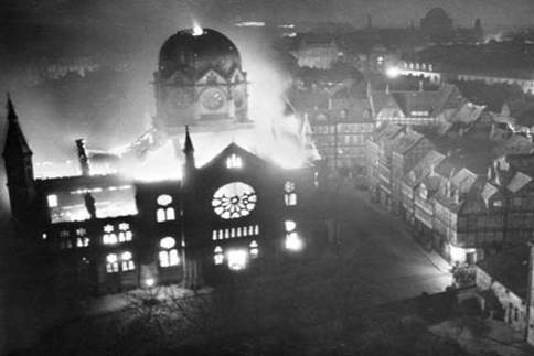 A SYNAGOGUE BURNS UNCHECKED DURING KRISTALLNACHT.