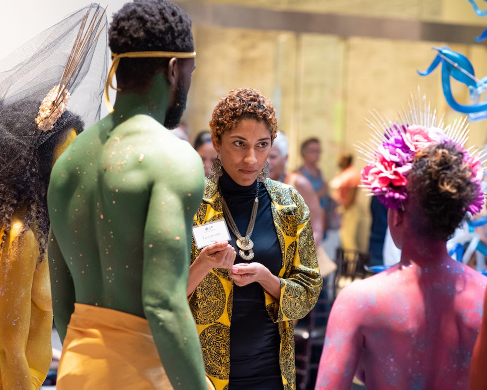 Artist and poet YaYa Delvalle, who exhibited her work at the 1st Thursdays event, shares an exchange with the Rainbow Myriads. - PHOTO BY MATT KELLER LEHMAN