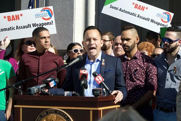 State Rep. Carlos Guillermo Smith stands alongside Pulse survivors. - PHOTO BY MONIVETTE CORDEIRO
