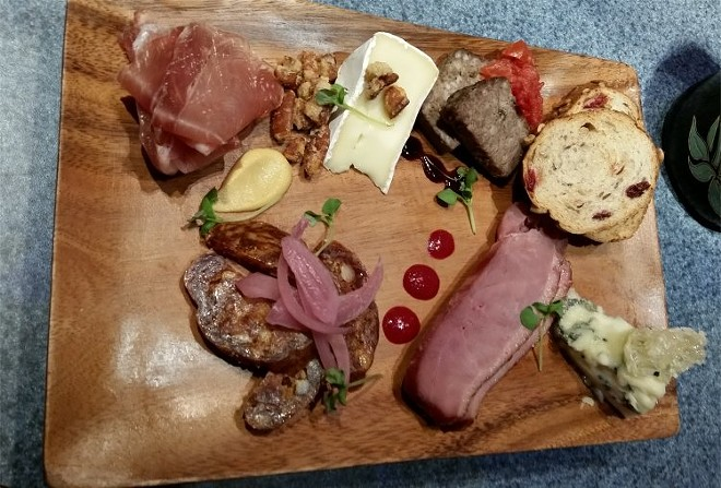Charcuterie palette, artisan cured meats, Nueske's applewood-smoked duck breast, cheese
