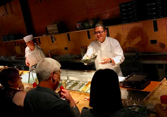 """Iron Chef Morimoto serves a guest at the last """"Momakase"""" dinner. - PHOTO COURTESY OF PATINA GROUP"""