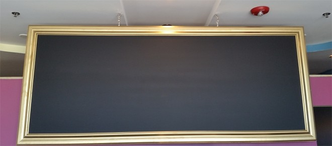 The gilded chalkboard will announce new flavor offerings