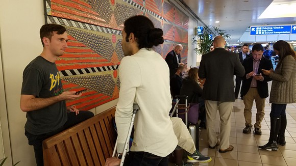 2:46: Reports of 20-hour waits and other travel delays happening elsewhere were shared and read in the airport hallway, while attorneys plugged laptops into wall outlets to research the orders. - DAVE PLOTKIN
