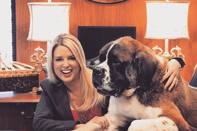 "Pam and her giant dog ""Cool Paw Luke"" - PHOTO VIA PAM BONDI/INSTAGRAM"