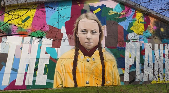 "A 2019 mural in Hillerød, Denmark by Danish artist Miki Pau Otkjær called ""Save the Planet Now"" depicts Swedish climate activist Greta Thunberg. - PHOTO VIA WIKIMEDIA COMMONS"