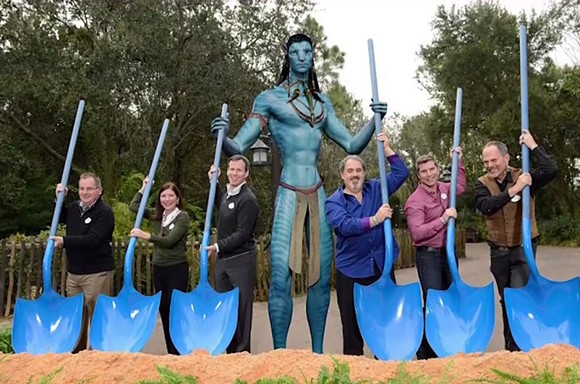Out of the five Disney executives in this 2014 Pandora groundbreaking ceremony photo, only two still remain at the company. An altered version of the photo, with the executives who are no longer at the company being removed from it, is on display within the land. - IMAGE VIA DISNEY
