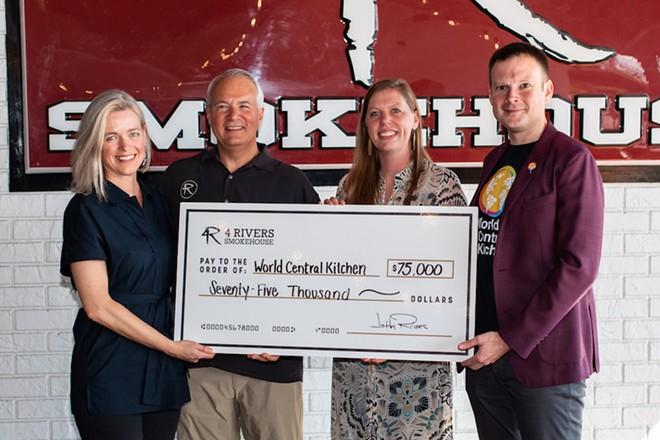 Sara Elliot and John Rivers of 4 Rivers Smokehouse present a check to Erin Gore and Nate Mook from World Central Kitchen for Hurricane Dorian Relief Efforts - PHOTO COURTSEY 4 RIVERS