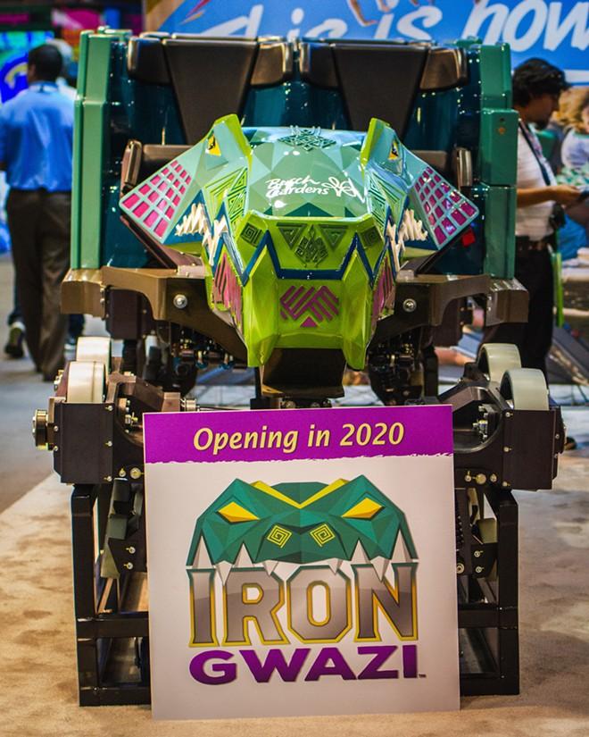 Iron Gwazi's ride vehicles and convention signage - IMAGE VIA FREDDY GRUNER