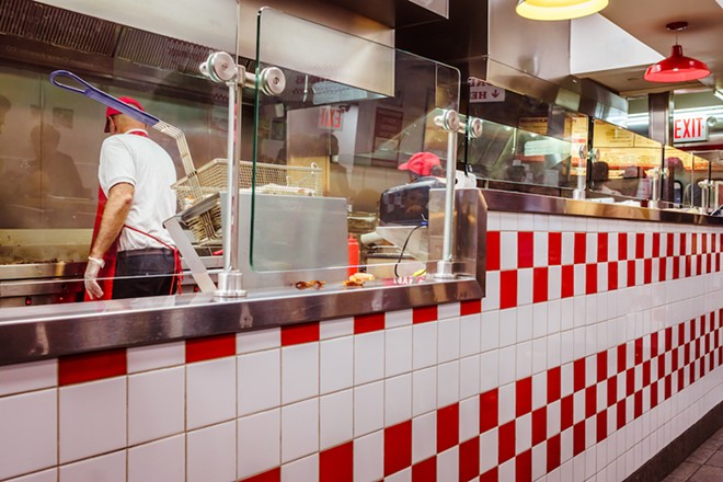 FIVE GUYS PHOTO VIA ADOBE STOCK