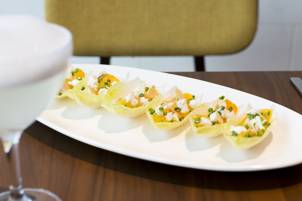 Jaleo's goat cheese endive, a dish that includes fresh oranges, almonds, goat cheese and a sherry dressing - PHOTO BY ROB BARTLETT