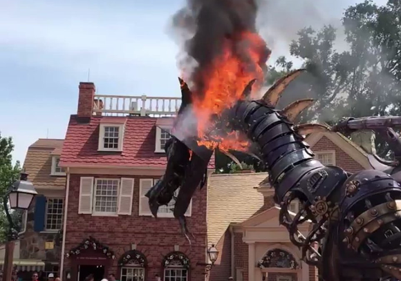 A dragon catches on fire at Walt Disney World in 2018 - SCREENSHOT VIA DARKAXIAN/YOUTUBE