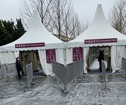 Body temperature checkpoints at the entrance of Shanghai Disneyland's shopping district. - IMAGE VIA GOURMETDDY | TWITTER